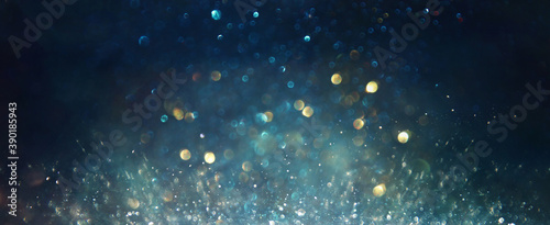 background of abstract glitter lights. silver, blue and black. de focused