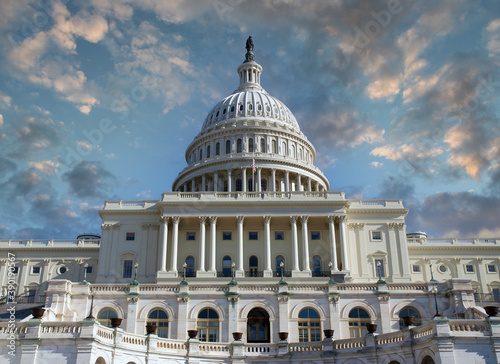 Fotografiet US Capitol dome in Washington DC. with sunrise sky.
