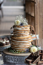 Two Tiered Chocolate Chip Cookie Wedding Cake With Dessert Table Barn Wedding