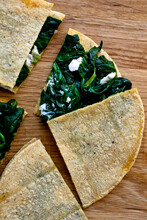Overhead View Of Spinach And Goat Cheese Quesadillas On Table
