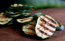 Close Up Of Spicy Grilled Zucchini On Cutting Board