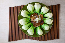 Overhead View Of Braised Chinese Mushrooms And Baby Bok Choy Served On Plate