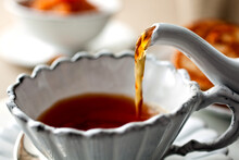 Close Up Of Tea Pouring In Tea...
