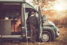 Men With RV Camper Van On A Camping