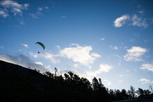 A Silhouette Of A Paraglider T...