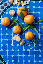 Tangerines On Blue Checkered Table