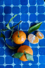 Mandarins With Green Leaves On...