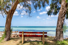 Park Bench At The Beach Looking Out Over The Clear Blue Ocean In Dunsborough Western Australia