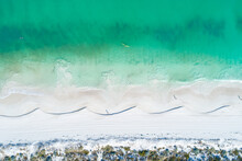 Aerial Top Down View Of Sandy White Beach In Summer