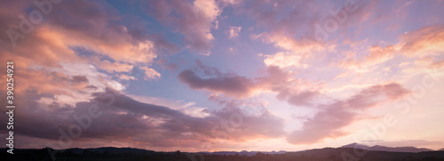 Obraz World environment day concept: Sky and clouds autumn sunset mountain background - fototapety do salonu