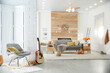 Cozy living room interior with comfortable furniture, guitar and autumn decor