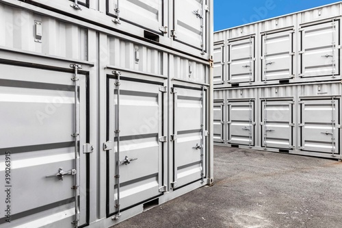 Stack of container shipping at dockyard in the port industrial area Canvas Print
