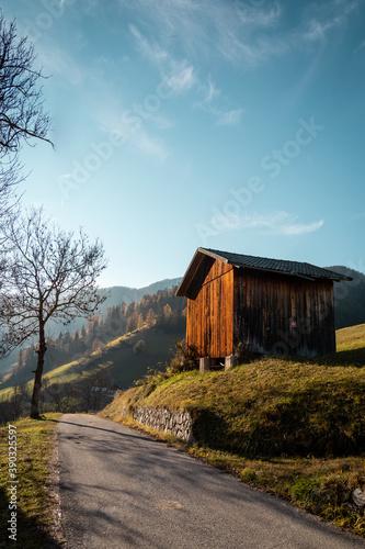 Tablou Canvas Enchanting little wooden shack or house in the italian Dolomite region, Trentino Alto Adige