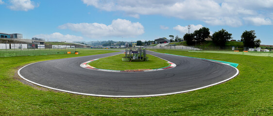 Hairpin bend turn in motorsport asphalt circuit scenic wide panoramic view