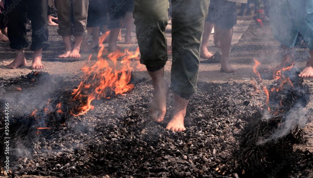 Fototapeta feet of people walking on hot coals