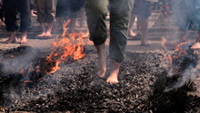 Feet Of People Walking On Hot Coals