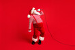 canvas print picture Full length body size view of his he handsome bearded talented Santa mc pj soloist vocalist star singing hit single having fun rest chill isolated bright vivid shine vibrant red color background