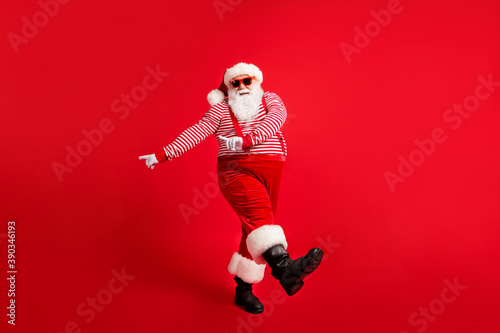 Obraz Full length body size view of his he nice handsome attractive cheerful Santa dancing having fun celebratory festal day x-mas occasion isolated bright vivid shine vibrant red color background - fototapety do salonu