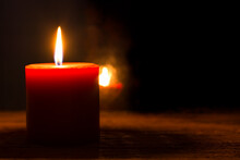 Single Burning Red Candle And ...
