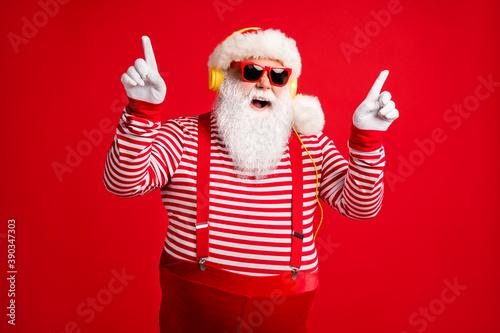 Vászonkép Portrait of his he handsome bearded fat overweight cheerful funny Santa listen s