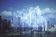 Double exposure of buildings hologram over cityscape background. Concept of smart city.
