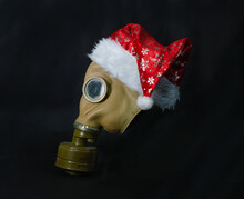 Photo Poster With An Old Army Gas Mask With A Santa Claus Cap.