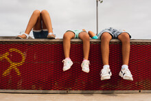 Kids Lying And Dangling Their Feet - Concept Of Friendship