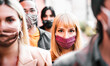 Leinwandbild Motiv Urban crowd of citizens walking on city street covered by face mask - New normal society concept with people on worried anxiety mood - Selective focus on blonde woman - Warm contrast filter