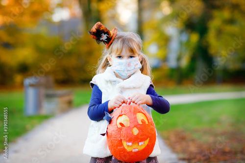 Canvastavla Toddler girl holding selfmade lantern for St
