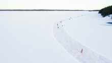 Aerial View Of Frozen Lake. Many Ice Skaters On The Ice. Winter Background Concept. Finland.
