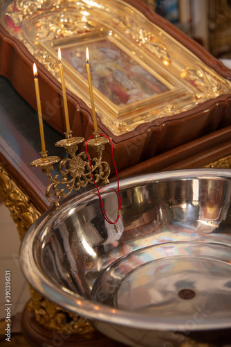 Fotografia, Obraz baptismal font for a child with an Orthodox cross
