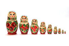 A Set Of Nesting Dolls Lined Up From Largest To Smallest