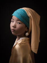 Painterly Studio Portrait Of A Girl Resembling 'girl With A Pearl Earring' By Dutch Oldmaster Vermeer