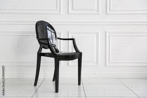 Foto black chair is in white room