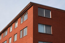 Corner Of A Building, Low Angle View, Windows In Rows, Residential Or Commercial.