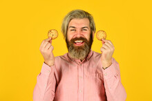 Excited Man Holding Cookies. B...