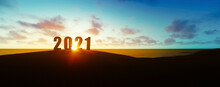 Silhouette Of Number 2021 On Seashore At Sunset New Year Celebration Concept