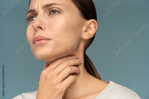 Closeup of sick woman having sore throat, tonsillitis, feeling sick, caught cold Fototapeta