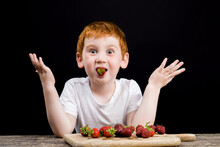 A Boy Eats Ripe Strawberries