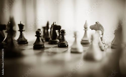 Fotografia, Obraz Wooden chess pieces on the chessboard.