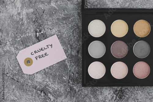 Obraz na plátne cruelty free vs animal tested cosmetics eyeshadow palettes with text on labels