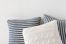 Striped And Knitted Cushions