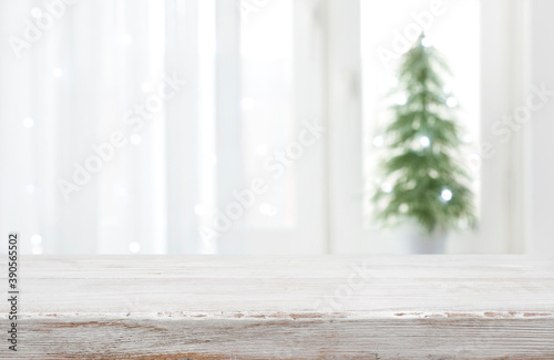 Obraz Empty vintage wood table in front of blurred holiday background - fototapety do salonu