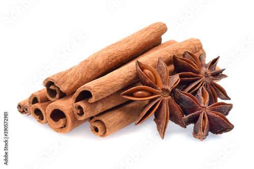 Fototapeta Spices cinnamon sticks, anise stars closed up isolated on white