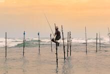 Stilt Fisherman Sitting In His...