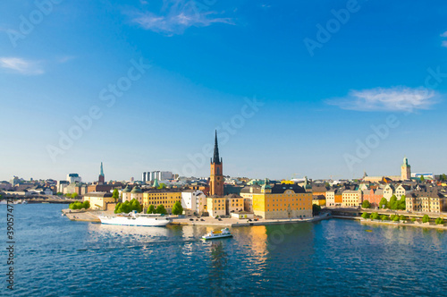 Watercolor drawing of Aerial panoramic top view of Riddarholmen district with Riddarholm Church and typical sweden gothic buildings, boat ship sailing on water of Lake Malaren in Stockholm, Sweden