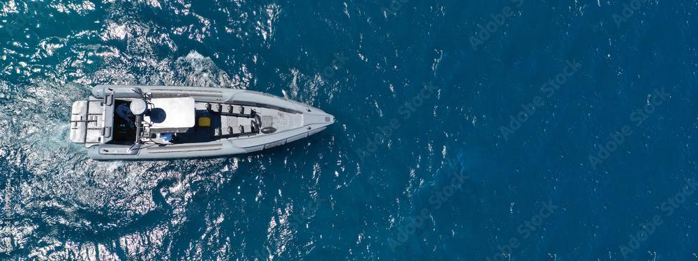 Fototapeta Aerial drone ultra wide photo of luxury inflatable speed boat cruising deep blue Aegean sea, Greece