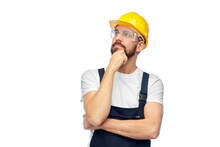 Profession, Construction And Building - Thinking Male Worker Or Builder In Yellow Helmet And Goggles Over White Background