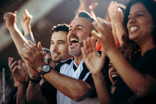 Obraz Group of soccer fans cheering their national team - fototapety do salonu
