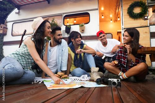 Fotografija Young travelers with world map planning trip near motorhome